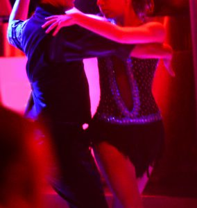 Couple dancing. cropped details and low light action portrait taken in available light.