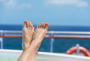 female feet on board a cruise ship - the concept of a cruise vacation